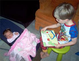 Sean reading to Maia