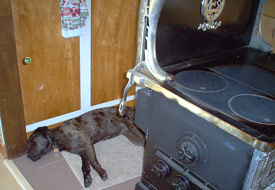 Sue behind wood stove